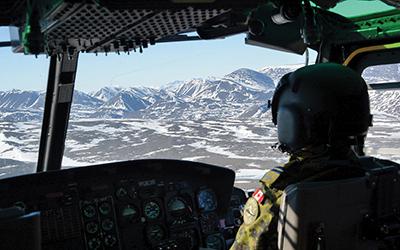 Pilot gazing out at Arctic vista.