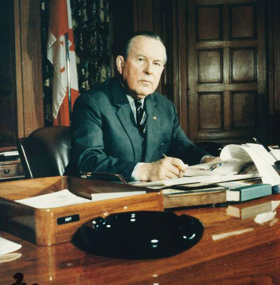The Right Honourable Lester B. Pearson sitting at his desk, Ottawa, Ontario