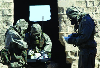 German soldiers specializing in nuclear, biological, and chemical warfare detection and decontamination on exercise near Kuwait City, 2003.