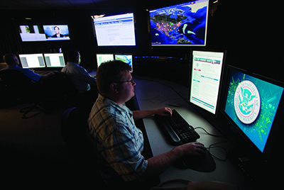 Analysts work in a watch and warning centre of the cyber security defence lab at the Idaho National Laboratory, September 2011.