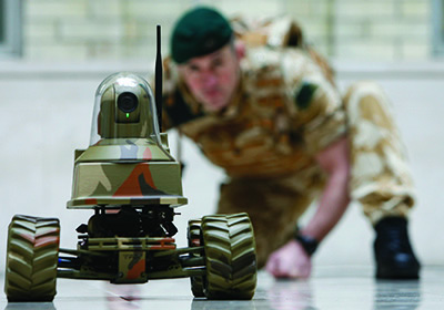 A Royal Marine with the Unmanned Vehicle Robot Testudo, at the launch of the Defence Technology Plan in London, February 2009.